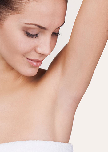 woman-in-shower-towel-looking-at-her-armpit